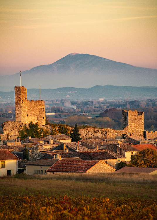 "Sunset over Aigueze with Mont Sainte Victoire in the distance. Aiguèze is a commune in the Gard department in southern France. Since 2005, Aiguèze has been a member of Les Plus Beaux Villages de France (""The most beautiful villages of France""), the first such location in Gard."