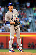 PHOENIX, AZ - JUNE 14:  Kenta Maeda #18 of the Los Angeles Dodgers looks for the sign from his catch in the first inning against the Arizona Diamondbacks at Chase Field on June 14, 2016 in Phoenix, Arizona.  (Photo by Jennifer Stewart/Getty Images)