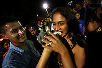 A man gives a shot of the local liquor to a woman during a party in the town plaza in Leiva, a small remote village in the southern Colombian state of Nariño, on Sunday, June 24, 2007. (Photo/Scott Dalton)