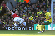 Picture by Paul Chesterton/Focus Images Ltd.  07904 640267.19/11/11.Robin Van Persie of Arsenal and Russell Martin of Norwich in action during the Barclays Premier League match at Carrow Road stadium, Norwich.