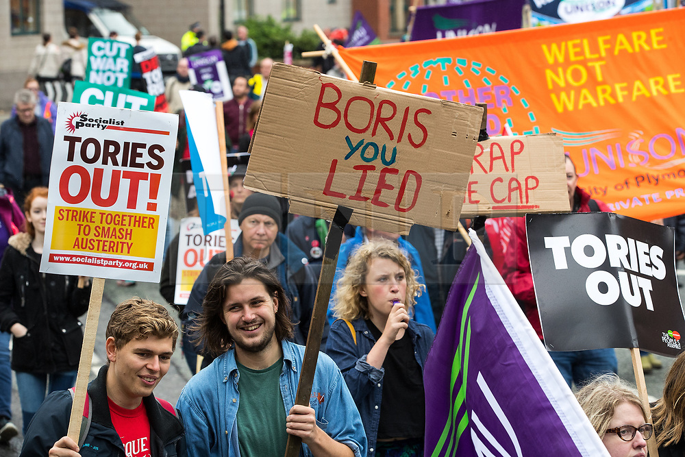 © Licensed to London News Pictures . 01/10/2017. Manchester, UK. Boris you lied placard in reference to Boris Johnson . Tories Out anti austerity demonstration against the Conservative Government in Manchester during the Conservative Party Conference , which is taking place at the Manchester Central Convention Centre . Photo credit: Joel Goodman/LNP
