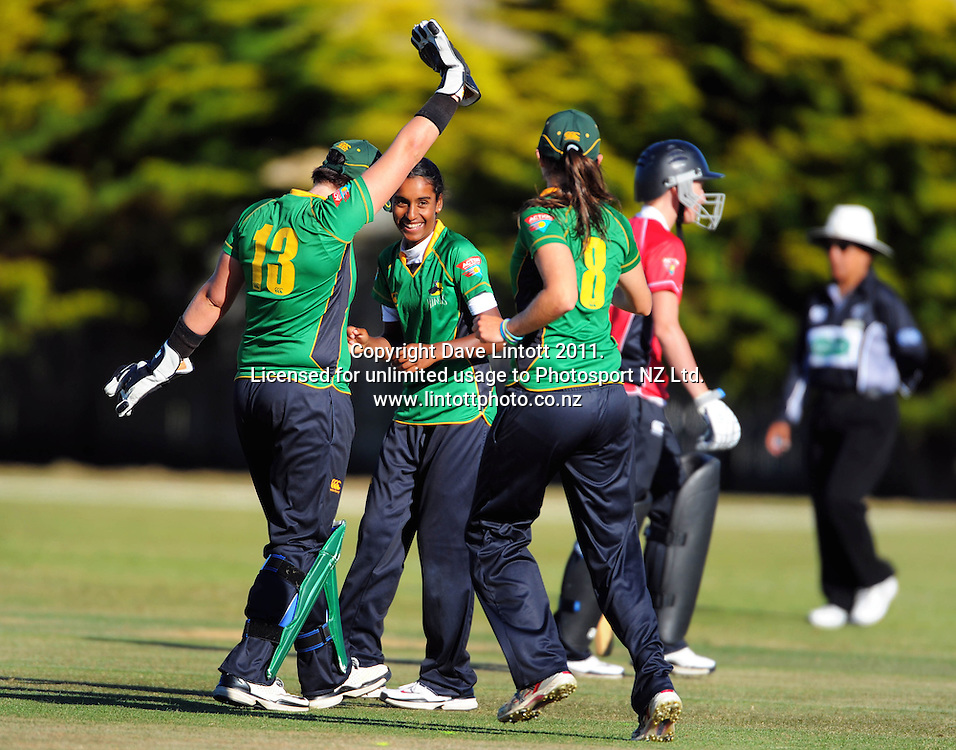 Rachel Priest (left) and Eimear Richardson congratulate Maneka Singh for her dismissal of Rachel Candy. Women's Twenty20 cricket - Central Hinds v Canterbury Magicians at Kena Kena Park, Paraparaumu Beach, Kapiti Coast, New Zealand on Friday, 14 January 2011. Photo: Dave Lintott / photosport.co.nz