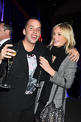 JOHN LYCETTE-GREEN and LEAH DE WAVRIN at a party to celebrate the launch of the new Vertu Constellation phone - the luxury phonemakers first touchscreen handset, held at the Farmiloe Building, St.John Street, Clarkenwell, London on 24th November 2011.