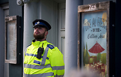 © Licensed to London News Pictures. 06/03/2018. Salisbury, UK. A police officer stands on guard outside Zizzi Restaurant in Salisbury, Wiltshire which is currently closed after former Russian spy Sergei Skripal and a woman in her 30s were taken ill with suspected poisoning. The couple where found unconscious on bench in Salisbury shopping centre. Specialist units have been called in to deal with any possible contamination. Photo credit: Ben Cawthra/LNP