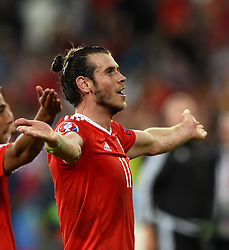 Gareth Bale of Wales celebrates with the Wales fans after the game  - Mandatory by-line: Joe Meredith/JMP - 01/07/2016 - FOOTBALL - Stade Pierre Mauroy - Lille, France - Wales v Belgium - UEFA European Championship quarter final