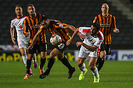 Will Grigg of Milton Keynes Dons (right) battles for the ball with Rory McArdle of Bradford City (23) during the Sky Bet League 1 match at stadium:mk, Milton Keynes<br /> Picture by David Horn/Focus Images Ltd +44 7545 970036<br /> 16/09/2014