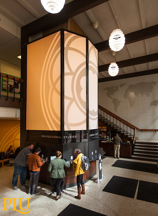 """Hauge entrance with the illuminated Rose Window wrap around the elevator and the remodeled area around including the """"Lute Cafe"""" food cart at PLU, Monday, Oct. 3, 2016. (Photo: John Froschauer/PLU)"""