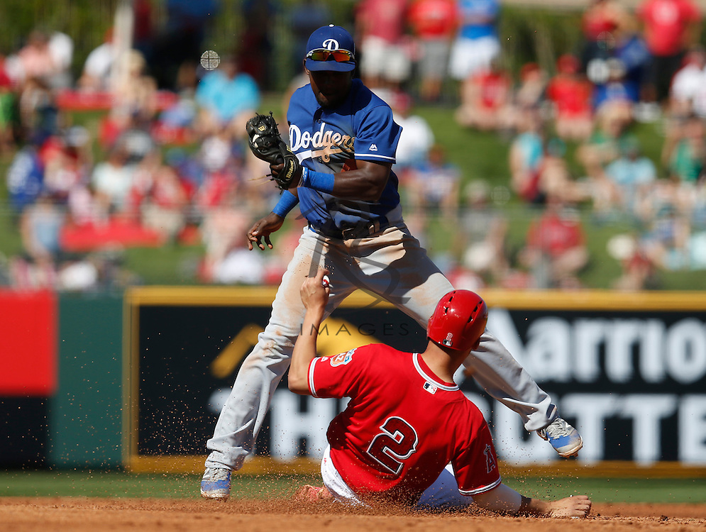 Mar 9, 2016; Tempe, AZ, USA; Los Angeles Angels shortstop Andrelton Simmons (2) steals second base in front of Los Angeles Dodgers second baseman Elian Herrera (48) in the first inning during a spring training game at Tempe Diablo Stadium. Mandatory Credit: Rick Scuteri-USA TODAY Sports