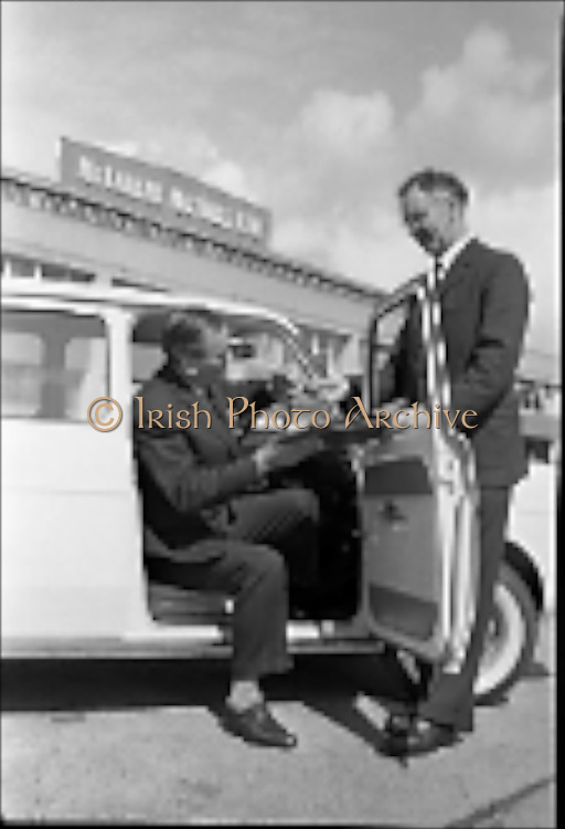 04/08/1962<br /> 08/04/1962<br /> 04 August 1962 <br /> Handing over Simca 1,000 to French Attache at McCairns Motors Ltd., Santry, Dublin. Picture shows the first Irish assembled Simca 1,000 being handed over by Mr Patrick Flanagan (right), general Works Manager, McCairns Motors Ltd. to the French Commercial Attache M. A. de Viggiani of the French Embassy, Dublin.