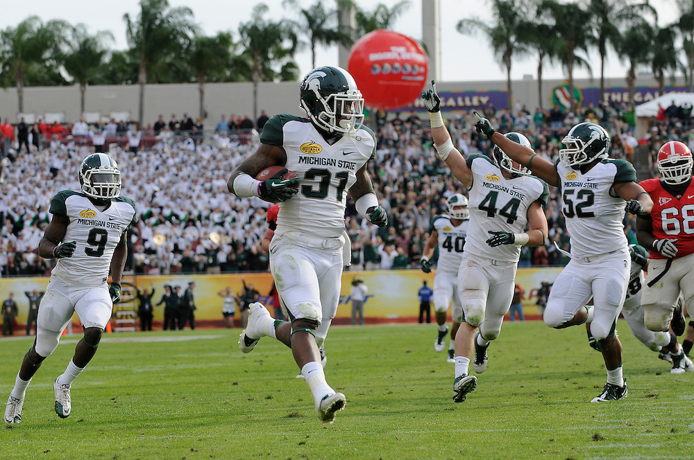 January 2, 2012: Darqueze Dennard of Michigan State returns an interception for a touchdown during the NCAA football game between the Michigan State Spartans and the Georgia Bulldogs at the 2012 Outback Bowl at Raymond James Stadium in Tampa, Florida. The Spartans defeated the Bulldogs 33-30.