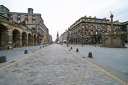 Edinburgh, Scotland, UK. 24 March, 2020.  Deserted streets in the heart of the Old Town tourist district in Edinburgh. All shops and restaurants are closed with very few people venturing outside following the Government imposed lockdown today. Pictured; A deserted Royal Mile. Iain Masterton/Alamy Live News