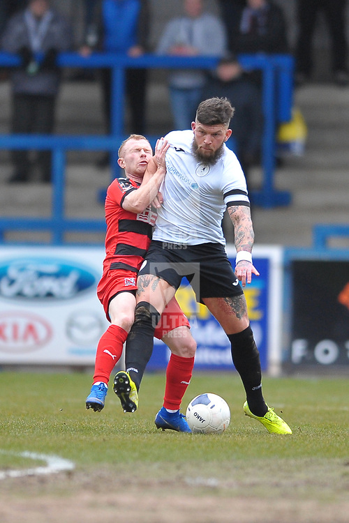 TELFORD COPYRIGHT MIKE SHERIDAN Shane Sutton of Telford holds off Adam Campbell during the Vanarama Conference North fixture between AFC Telford United and Darlington at The New Bucks Head on Saturday, March 7, 2020.<br /> <br /> Picture credit: Mike Sheridan/Ultrapress<br /> <br /> MS201920-049