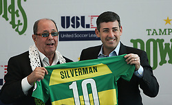 October 2, 2018 - St. Petersburg, Florida, U.S. - Bill Edwards and Matt Silverman show off the Silverman Rowdies jersey during a press conference to announce the Rays buying the Rowdies at Mahaffey Theatre, 400 1st St S, in St. Petersburg, Tuesday morning.(Credit Image: © Dirk Shadd/Tampa Bay Times via ZUMA Wire)