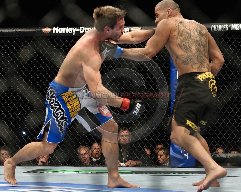 "BIRMINGHAM, ENGLAND, NOVEMBER 5, 2012: Brad Pickett (left) is caught by an uppercut from Renan Barao during ""UFC 138: Munoz vs. Leben"" inside the National Indoor Arena in Birmingham, United Kingdom"