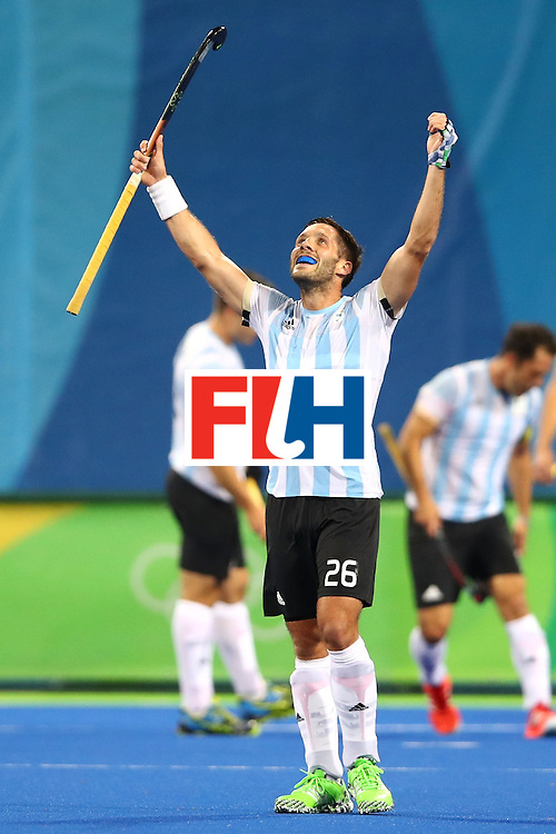 RIO DE JANEIRO, BRAZIL - AUGUST 18:  Agustin Mazzilli #26 of Argentina celebrates winning the Men's Hockey Gold Medal match between Belgium and Argentina on Day 13 of the Rio 2016 Olympic Games at Olympic Hockey Centre on August 18, 2016 in Rio de Janeiro, Brazil.  (Photo by Clive Brunskill/Getty Images)