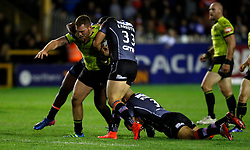 Hull FC's Scott Taylor is tackled by Castleford Tigers Gadwin Springer (left) Kevin Larroyer (centre) and Jake Webster during the Betfred Super 8s match at the Mend-A-Hose Jungle, Castleford.