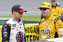 June 10, 2018 - Brooklyn, Michigan, U.S - NASCAR drivers KEVIN HARVICK (4) and KYLE BUSCH (18) wait for the rain to clear up at Michigan International Speedway. (Credit Image: © Scott Mapes via ZUMA Wire)