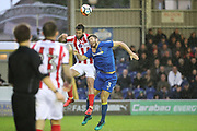 AFC Wimbledon defender Jon Meades (3) battles for possession during the The FA Cup match between AFC Wimbledon and Lincoln City at the Cherry Red Records Stadium, Kingston, England on 4 November 2017. Photo by Matthew Redman.