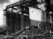 OLYMPIC and TITANIC - view of bows [in shipyard construction scaffolding] Date Created/Published: [between 1909 and 1911] Medium: 1 photographic print.