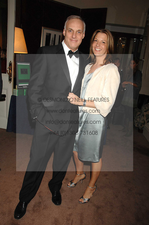 TANIA FOSTER-BROWN and NICK HOLLINGWORTH at a party to celebrate the publication of Top Tips For Girls by Kate Reardon held at Claridge's, Brook Street, London on 28th January 2008.<br />