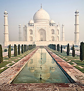 Reflection of Taj Mahal in a pool flanked by gardens and walkways.<br /> (Photo by Matt Considine - Images of Asia Collection)