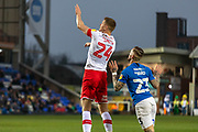 Michael Smith (24) clears ahead of Joe Ward (23) during the EFL Sky Bet League 1 match between Peterborough United and Rotherham United at London Road, Peterborough, England on 25 January 2020.