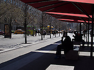 Under the umbrellas at the David H. Koch Plaza in front of the Metropolitan Museum.