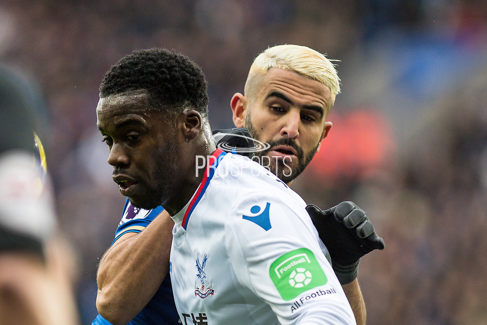Crystal Palace #15 Jeffrey Schlupp, Leicester City (26) Riyad Mahrez during the Premier League match between Leicester City and Crystal Palace at the King Power Stadium, Leicester, England on 16 December 2017. Photo by Sebastian Frej.