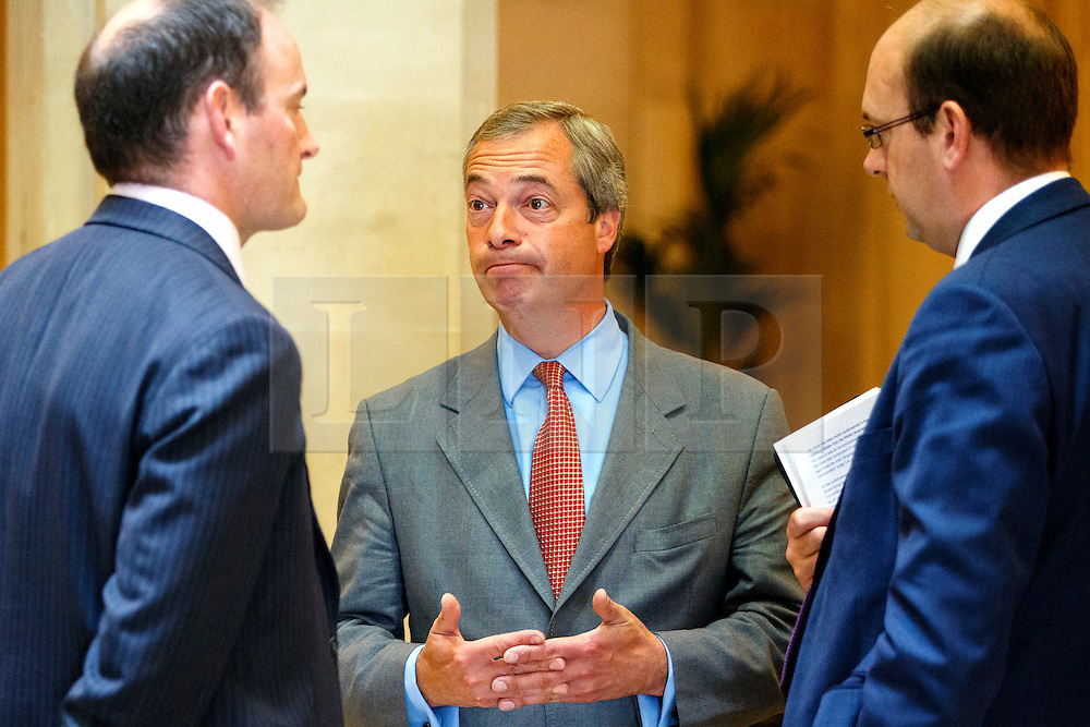 """© Licensed to London News Pictures. 17/06/2015. London, UK. UKIP leader NIGEL FARAGE talking to UKIP MP DOUGLAS CARSWELL and MARK RECKLESS before launching """"The Truth About Trade Beyond The EU"""" pamphlet in central London, on Wednesday, June 17, 2015. Photo credit: Tolga Akmen/LNP"""