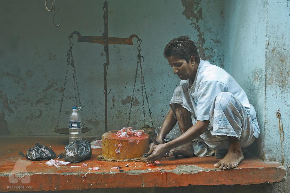 Butcher at the Barabazar market, Kolkata, West Bengal, India.