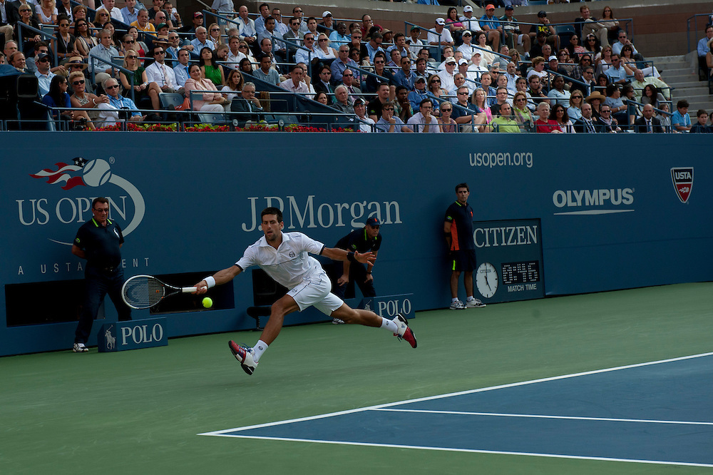 NEW YORK, NY - SEPTEMBER 12: Novak Djokovic of Serbia stretches for a ball against Rafael Nadal of Spain during the Men's Final on Day Fifteen of the 2011 US Open at the USTA Billie Jean King National Tennis Center on September 12, 2011 in the Flushing neighborhood of the Queens borough of New York City. (Photo by Rob Tringali) *** Local Caption *** Novak Djokovic