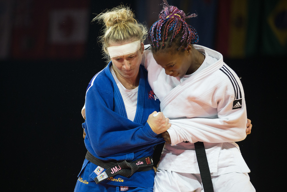 Hannah Martin (L) of the United States struggles with  Maylin Del Toro of Cuba during the bronze medal contest in the women's judo -63kg class at the 2015 Pan American Games in Toronto, Canada, July 13,  2015.  AFP PHOTO/GEOFF ROBINS