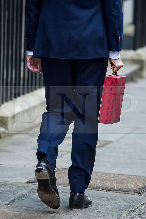 © Licensed to London News Pictures. 16/03/2016. London, UK. Chancellor of the Exchequer George Osborne leaves 11 Downing Street before presenting his budget to Parliament on Wednesday, 16 March 2016. Photo credit: Ben Cawthra/LNP