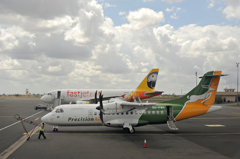 DAR ES SALAAM, TANZANIA -  13-10-07  - Precision Air and Fastjet planes at Julius Nyerere International Airport (DAR) in Dar es Salaam, Tanzania on October 7.  Photo by Daniel Hayduk
