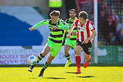 Control from Forest Green Rovers midfielder, on loan from Birmingham City, Charlie Cooper (20)  during the Vanarama National League match between Lincoln City and Forest Green Rovers at Sincil Bank, Lincoln, United Kingdom on 25 March 2017. Photo by Simon Davies.