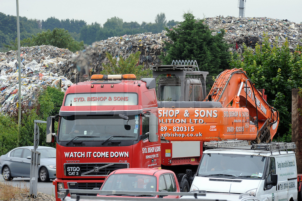 © Licensed to London News Pictures. 11/07/2014<br /> A view from near by Crittals Corner round about and the A20 flyover.<br /> The Environment Agency has two officers posted out side the Waste4fuel site in Kent after local people reported seeing three lorry loads of waste being delivered on Monday (7.07.2014) to the St Pauls Cray site.  The Environment Agency has served an enforcement notice on Waste4Fuel to stop any further waste being brought into the site. <br /> This means any person depositing waste at Waste4Fuel will be committing an offence and may face action from the Environment Agency. <br /> Several conditions need to be met before further waste can be accepted at the site. <br /> The Environment Agency is waiting for a written decision from the High Court after it dismissed a contempt of court case last week for failure to maintain fire breaks and store new waste separately at the site. <br /> <br /> (Byline:Grant Falvey/LNP)