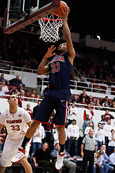 February 3, 2011; Stanford, CA, USA;  Arizona Wildcats forward Jesse Perry (33) shoots past Stanford Cardinal forward Dwight Powell (33) during the first half at Maples Pavilion.