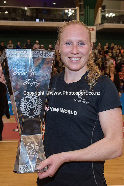 New Zealand's captain Laura Langman holds the Taini Jamison Trophy during the Silver Ferns vs England netball match in Palmerston North on Friday the 31st of October 2014. Photo by Marty Melville/www.Photosport.co.nz