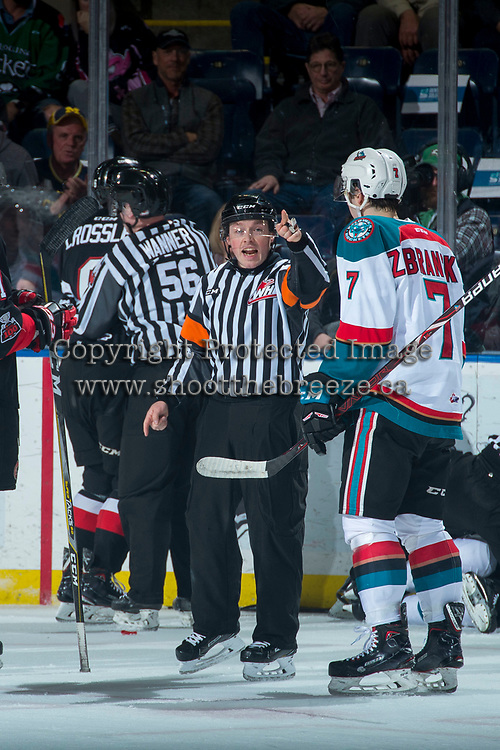 KELOWNA, CANADA - MARCH 14: Referee Mark Pearce sends players to the penalty box at the Kelowna Rockets against the Prince George Cougars  on March 14, 2018 at Prospera Place in Kelowna, British Columbia, Canada.  (Photo by Marissa Baecker/Shoot the Breeze)  *** Local Caption ***