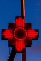 The Zia symbol (Ancient sun symbol), Serafin's Chile Hut on Central Avenue (Historic Route 66) in the Nob Hill section of Albuquerque, New Mexico USA.