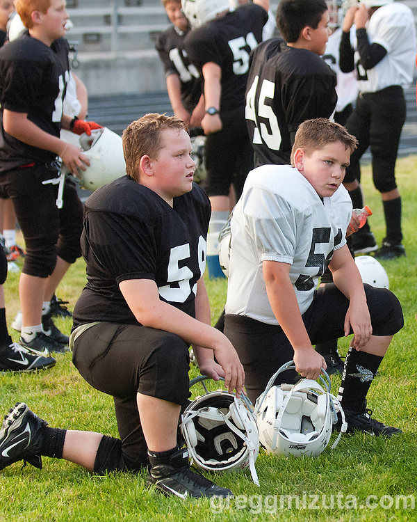Vale fifth graders Dakota Shepard and Trent Aldred before the Vale Broncos and Vale Cowboys Eastern Oregon Youth Football Championship game on October 12, 2013 at Ontario High School, Ontario, Oregon. The Broncos won the games 21-14.