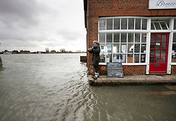 © Licensed to London News Pictures. 10/02/2020. Bosham, UK. High tide flood water surrounds The Breeze Cafe in Bosham as the effects of storm Ciara are still being felt in parts of the UK. Photo credit: Peter Macdiarmid/LNP