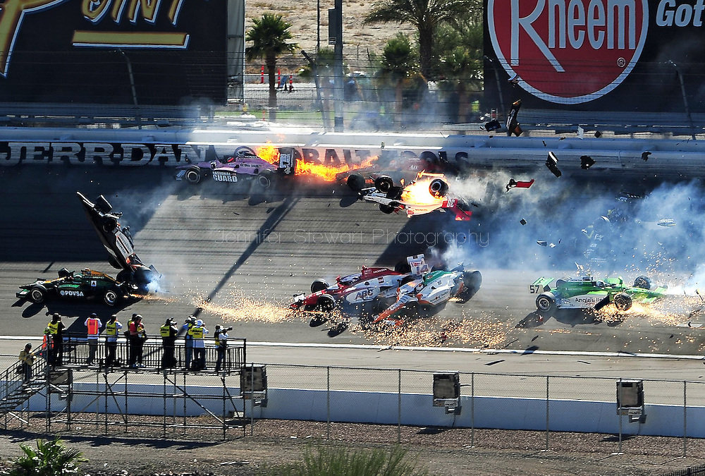 Oct. 16 2011; Las Vegas, NV, USA; Indy Car series drivers Dan Wheldon (77) , JR Hildebrand (4) , Vitor Meira (14) , Charlie Kimball (83) and Tomas Scheckter (57) crash as Pippa Mann (30) flies through the air as Alex Lloyd (19) and Will Power (12) crash during the IZOD IndyCar World Championships at Las Vegas Motor Speedway.  Mandatory Credit: Jennifer Stewart-US PRESSWIRE