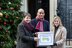 London, UK. 3rd December, 2018. Caroline Lucas MP, People's Vote spokesman Chuka Umunna MP and Justine Greening MP delivers a Final Say petition signed by over a million people to 10 Downing Street to be presented to Prime Minister Theresa May following her return from the G20 summit in Buenos Aires.