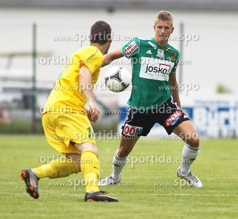22.06.2012, Sportplatz SK Kammer, Kammer, AUT, 1. FBL, Testspiel, SV Josko Ried vs MSK Zilina, im Bild Jan Novak, (MSK Zilina, #14) und Thomas Hinum, (SV Josko Ried, #18)// Jan Novak, (MSK Zilina, #14) und Thomas Hinum, (SV Josko Ried, #18)during Preparation Game for the 1. FBL between SV Josko Ried and MSK Zilina at the Sportplatz SK Kammer, Kammer, Austria on 2012/06/22 . EXPA Pictures © 2012, PhotoCredit: EXPA/ R. Hackl