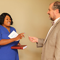 Kimberly Jeter, left, gets her key for her Habitat for Humanity from Andy Estes Friday morning.
