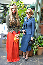 Left to right, BRYONY DANIELS and MARTHA SITWELL at a party to celebrate 'A Year In The Garden' celebrating the first year of The Ivy Chelsea Garden, 197 King's Road, London on 16th May 2016.