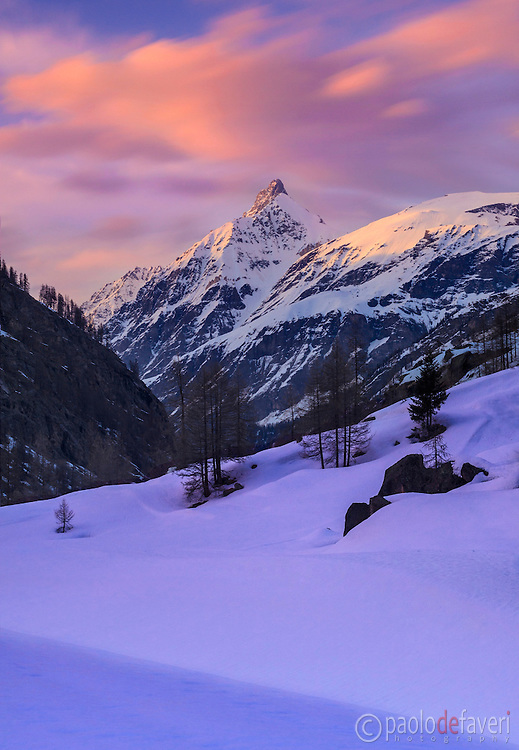 A moody sunset with some beautiful light and clouds in Valasavarenche, one of the many valleys of the Gran Paradiso National Park, the largest wild area of italy, in the western Alps. Taken on a very cold evening at the beginning of April.
