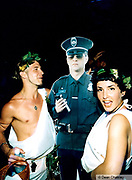 Two clubbers dressed as Adam and Eve with a cardboard cutout of a policeman Ibiza 1999