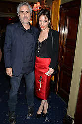 SHEHERAZADE GOLDSMITH and ALFONSO CUARON at The Hoping Foundation's 'Starry Starry Night' Benefit Evening For Palestinian Refugee Children held at The Cafe de Paris, Coventry Street, London on 19th June 2014.